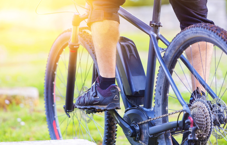 Photo wallpaper wheels, bicycle, legs, man, gears, transport