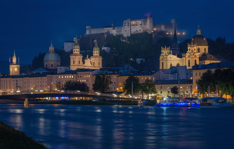 Photo wallpaper night, the city, river, mountain, Austria, lighting, Church, temple, fortress, Salzburg, The Salzach, Hohensalzburg, Festung