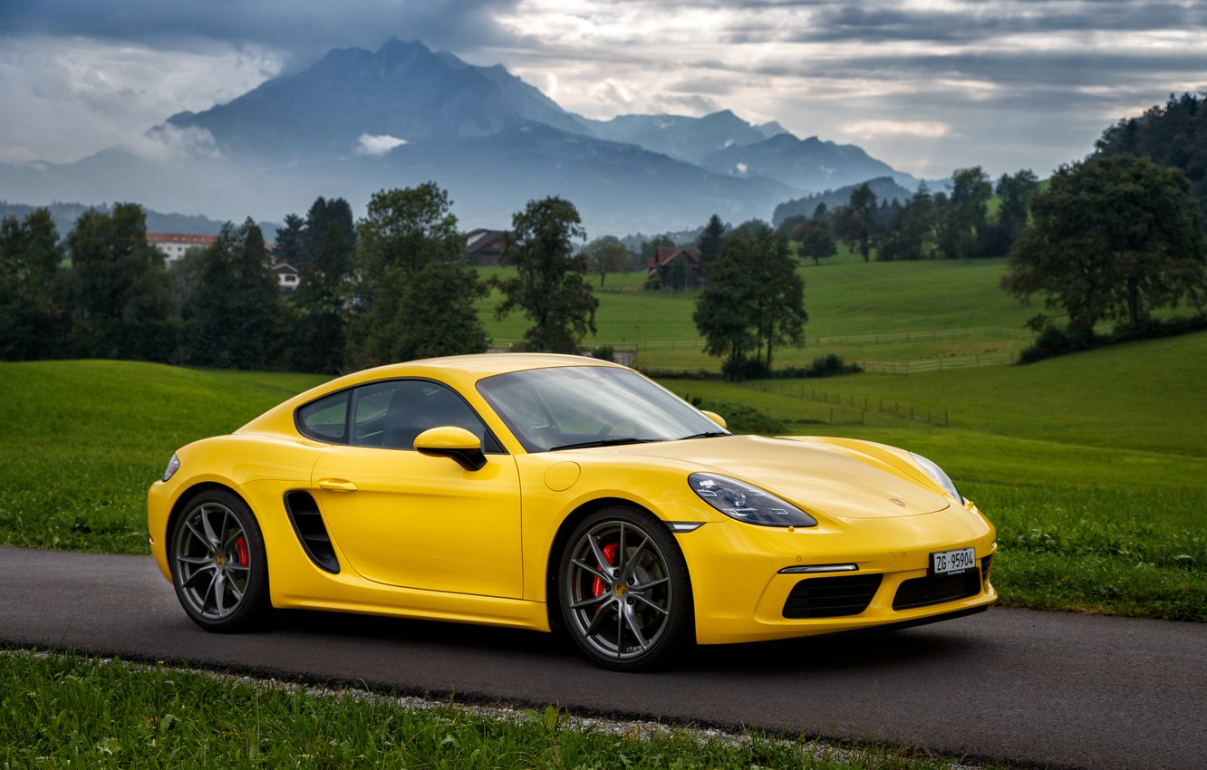 Photo wallpaper road, clouds, trees, mountains, Yellow, Grass, Porsche, Porsche, Porsche, Lawn, Porsche Cayman