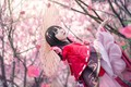Picture look, girl, trees, flowers, branches, red, face, cherry, pose, style, umbrella, mood, red, portrait, spring, ...